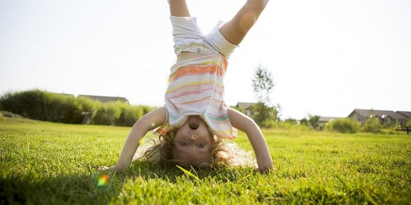 Toddler playing in yard.